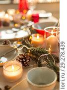 Купить «table served and decorated for christmas dinner», фото № 29278439, снято 14 декабря 2017 г. (c) Syda Productions / Фотобанк Лори