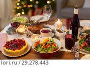 Купить «food and drinks on christmas table at home», фото № 29278443, снято 17 декабря 2017 г. (c) Syda Productions / Фотобанк Лори