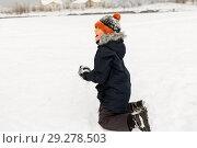 Купить «happy little boy playing with snow in winter», фото № 29278503, снято 10 февраля 2018 г. (c) Syda Productions / Фотобанк Лори