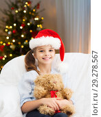 Купить «smiling little girl with teddy bear on christmas», фото № 29278567, снято 9 октября 2013 г. (c) Syda Productions / Фотобанк Лори
