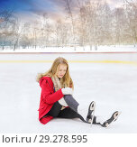Купить «young woman fell down on outdoor skating rink», фото № 29278595, снято 26 ноября 2014 г. (c) Syda Productions / Фотобанк Лори