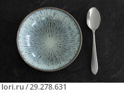 Купить «close up of ceramic plate and spoon on table», фото № 29278631, снято 4 апреля 2018 г. (c) Syda Productions / Фотобанк Лори
