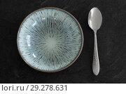 Купить «close up of ceramic plate and spoon on table», фото № 29278631, снято 4 апреля 2018 г. (c) Syda Productions / Фотобанк Лори