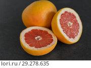 Купить «close up of fresh juicy grapefruits», фото № 29278635, снято 4 апреля 2018 г. (c) Syda Productions / Фотобанк Лори