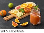 Купить «mason jar glass of fruit juice on slate table top», фото № 29278655, снято 4 апреля 2018 г. (c) Syda Productions / Фотобанк Лори