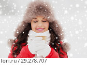 Купить «happy woman in winter fur hat with coffee outdoors», фото № 29278707, снято 7 января 2017 г. (c) Syda Productions / Фотобанк Лори