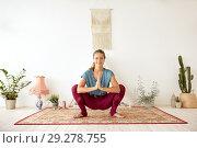 Купить «young woman doing garland pose at yoga studio», фото № 29278755, снято 21 июня 2018 г. (c) Syda Productions / Фотобанк Лори