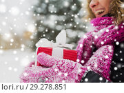 Купить «close up of woman with christmas gift outdoors», фото № 29278851, снято 11 ноября 2016 г. (c) Syda Productions / Фотобанк Лори
