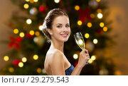 Купить «woman with glass of champagne on christmas», фото № 29279543, снято 1 июня 2014 г. (c) Syda Productions / Фотобанк Лори