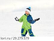 Купить «happy boy playing and throwing snowball in winter», фото № 29279579, снято 10 февраля 2018 г. (c) Syda Productions / Фотобанк Лори
