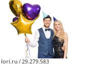 Купить «happy couple with party caps and balloons», фото № 29279583, снято 3 марта 2018 г. (c) Syda Productions / Фотобанк Лори