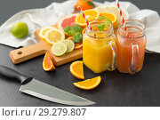 Купить «mason jar glasses with juice and fruits on table», фото № 29279807, снято 4 апреля 2018 г. (c) Syda Productions / Фотобанк Лори