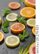 Купить «close up of grapefruit, orange, pomelo and lime», фото № 29279831, снято 4 апреля 2018 г. (c) Syda Productions / Фотобанк Лори