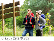 Купить «couple of travelers with backpacks at signpost», фото № 29279855, снято 31 августа 2014 г. (c) Syda Productions / Фотобанк Лори