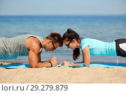 Купить «couple doing plank exercise on summer beach», фото № 29279879, снято 1 августа 2018 г. (c) Syda Productions / Фотобанк Лори