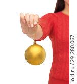 Купить «close up of woman hand holding christmas ball», фото № 29280067, снято 10 сентября 2014 г. (c) Syda Productions / Фотобанк Лори
