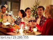 Купить «happy friends celebrating christmas at home feast», фото № 29280155, снято 17 декабря 2017 г. (c) Syda Productions / Фотобанк Лори