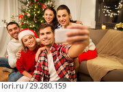 Купить «friends celebrating christmas and taking selfie», фото № 29280159, снято 17 декабря 2017 г. (c) Syda Productions / Фотобанк Лори