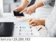 Купить «web designers creating mobile user interface», фото № 29280183, снято 17 января 2018 г. (c) Syda Productions / Фотобанк Лори