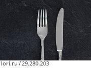 Купить «close up of fork and knife on table», фото № 29280203, снято 4 апреля 2018 г. (c) Syda Productions / Фотобанк Лори