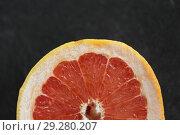 Купить «close up of fresh juicy grapefruit», фото № 29280207, снято 4 апреля 2018 г. (c) Syda Productions / Фотобанк Лори