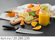 Купить «mason jar glass with juice and fruits on table», фото № 29280235, снято 4 апреля 2018 г. (c) Syda Productions / Фотобанк Лори