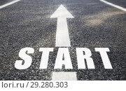 Купить «close up of arrow and word start on asphalt road», фото № 29280303, снято 10 февраля 2018 г. (c) Syda Productions / Фотобанк Лори
