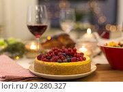 Купить «cake and other food on christmas table at home», фото № 29280327, снято 17 декабря 2017 г. (c) Syda Productions / Фотобанк Лори