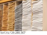 Купить «close up of shelves with clothes at clothing store», фото № 29280367, снято 10 февраля 2018 г. (c) Syda Productions / Фотобанк Лори