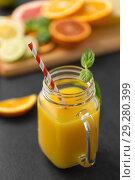 Купить «mason jar glass of fruit juice on slate table top», фото № 29280399, снято 4 апреля 2018 г. (c) Syda Productions / Фотобанк Лори