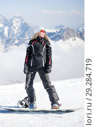 Купить «Young adult woman snowboarder holding snow board», фото № 29284719, снято 18 марта 2018 г. (c) katalinks / Фотобанк Лори