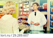 Купить «Experienced pharmacist counseling female customer in farmacy», фото № 29289607, снято 16 декабря 2018 г. (c) Яков Филимонов / Фотобанк Лори