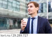 Купить «Portrait of cheerful male standing outdoor», фото № 29289727, снято 29 апреля 2017 г. (c) Яков Филимонов / Фотобанк Лори
