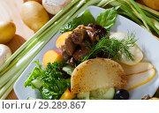 Купить «Chicken hearts in salad with roasted cheese, peach, pear», фото № 29289867, снято 10 декабря 2018 г. (c) Яков Филимонов / Фотобанк Лори
