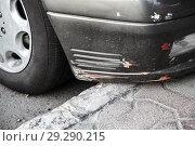 Купить «Damaged front car bumper with scratches», фото № 29290215, снято 18 мая 2018 г. (c) EugeneSergeev / Фотобанк Лори