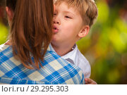 Купить «Boy plays with his mom and says something to her», фото № 29295303, снято 10 ноября 2017 г. (c) Pavel Biryukov / Фотобанк Лори
