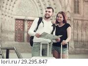 Купить «Couple of two young tourists with baggage», фото № 29295847, снято 25 мая 2017 г. (c) Яков Филимонов / Фотобанк Лори