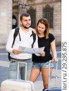 Купить «Portrait of young couple with map and baggage», фото № 29295875, снято 25 мая 2017 г. (c) Яков Филимонов / Фотобанк Лори