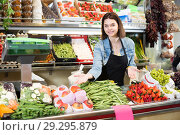 Pretty woman seller displaying assortment. Стоковое фото, фотограф Яков Филимонов / Фотобанк Лори