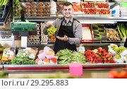 Купить «Man seller is weighing grapes», фото № 29295883, снято 18 марта 2017 г. (c) Яков Филимонов / Фотобанк Лори