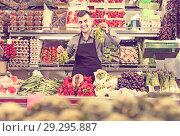 Купить «Male shopping assistant weighing grapes in grocery shop», фото № 29295887, снято 18 марта 2017 г. (c) Яков Филимонов / Фотобанк Лори