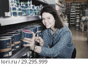 Купить «female customer examining various wall paints in paint store», фото № 29295999, снято 9 марта 2017 г. (c) Яков Филимонов / Фотобанк Лори
