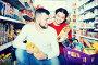 Купить «Smiling family couple buying vegetable oil», фото № 29296027, снято 14 марта 2017 г. (c) Яков Филимонов / Фотобанк Лори
