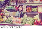 Купить «Female seller displaying assortment», фото № 29296091, снято 18 марта 2017 г. (c) Яков Филимонов / Фотобанк Лори