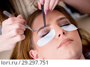 Купить «Young woman getting eyelash extension», фото № 29297751, снято 29 января 2018 г. (c) Elnur / Фотобанк Лори