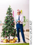 Купить «Employee businessman celebrating christmas in office», фото № 29297827, снято 14 июля 2018 г. (c) Elnur / Фотобанк Лори