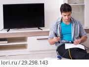 Купить «Man trying to fix broken tv», фото № 29298143, снято 9 марта 2018 г. (c) Elnur / Фотобанк Лори