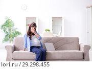 Купить «Pregnant woman relaxing on the sofa», фото № 29298455, снято 28 декабря 2017 г. (c) Elnur / Фотобанк Лори