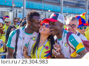 Купить «Russia, Samara, June 2018: A cheerful football fan from Senegal kisses a fan from Colombia.», фото № 29304983, снято 28 июня 2018 г. (c) Акиньшин Владимир / Фотобанк Лори