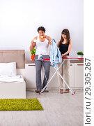 Купить «Young woman doing ironing for her husband», фото № 29305267, снято 27 июня 2018 г. (c) Elnur / Фотобанк Лори
